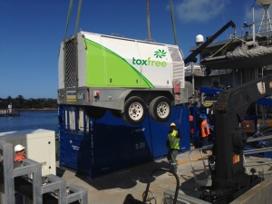 Toxfree equipment being loaded on to the boat, ready to be taken out to the platform.